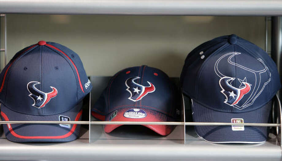 Team caps aren't spending much time on the shelf at the Go Texans Store. Photo: James Nielsen, Houston Chronicle