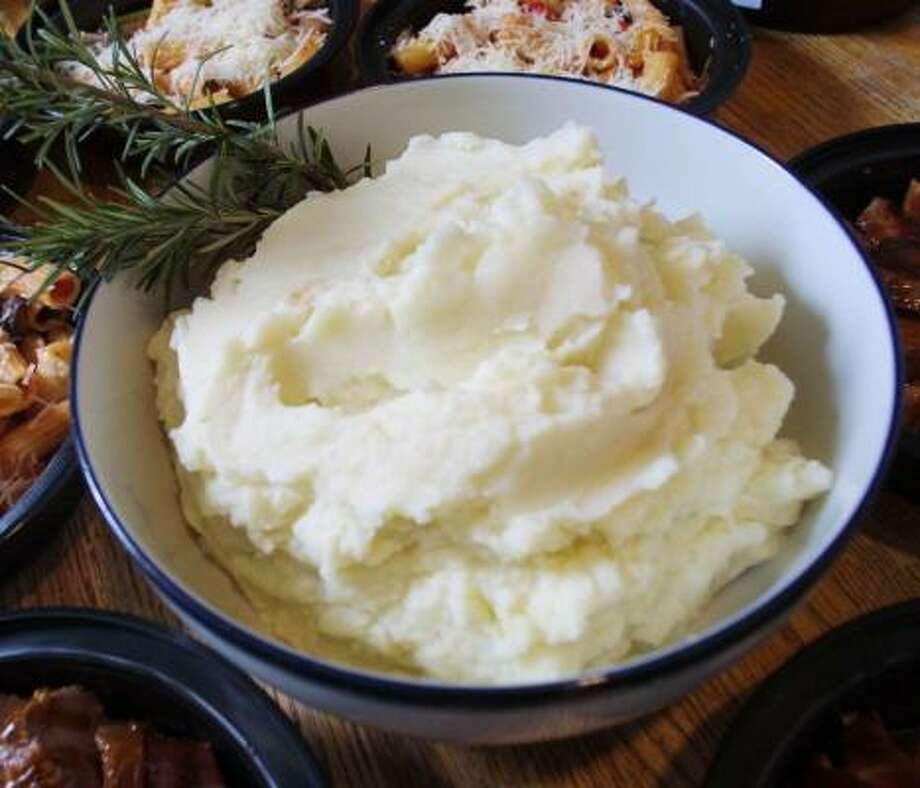 One of the tricks to making Perfect Mashed Potatoes is to warm the milk and butter before mixing. Photo: PHILADELPHIA DAILY NEWS FILE