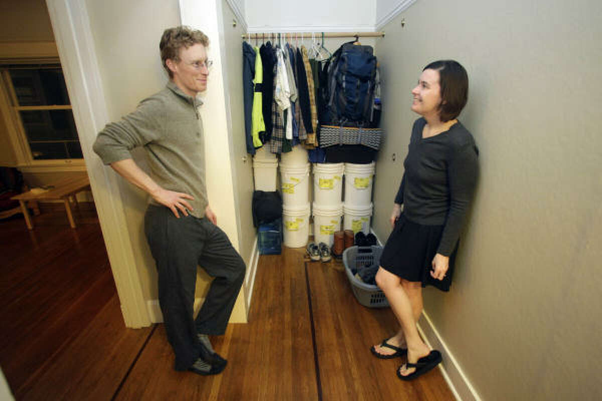 """Tammy Strobel and her husband, Logan Smith, live in a 400-square-foot apartment in Portland, Ore. Strobel has eliminated possessions with a """"100 Thing Challenge,"""" a number that includes books, shoes, clothes and personal hygiene products."""