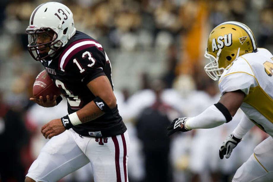 Texas Southern quarterback Riko Smalls (13) runs for a first down. Photo: Smiley N. Pool, Chronicle