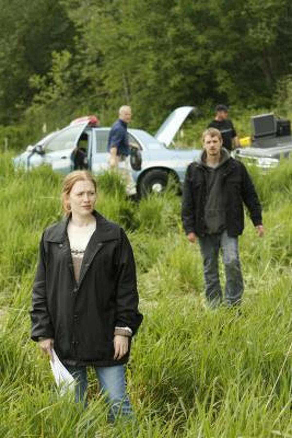 Houston native Mireille Enos portrays Detective Sarah Linden and Joel Kinnaman portrays Detective Stephen Holder in the AMC series The Killing.