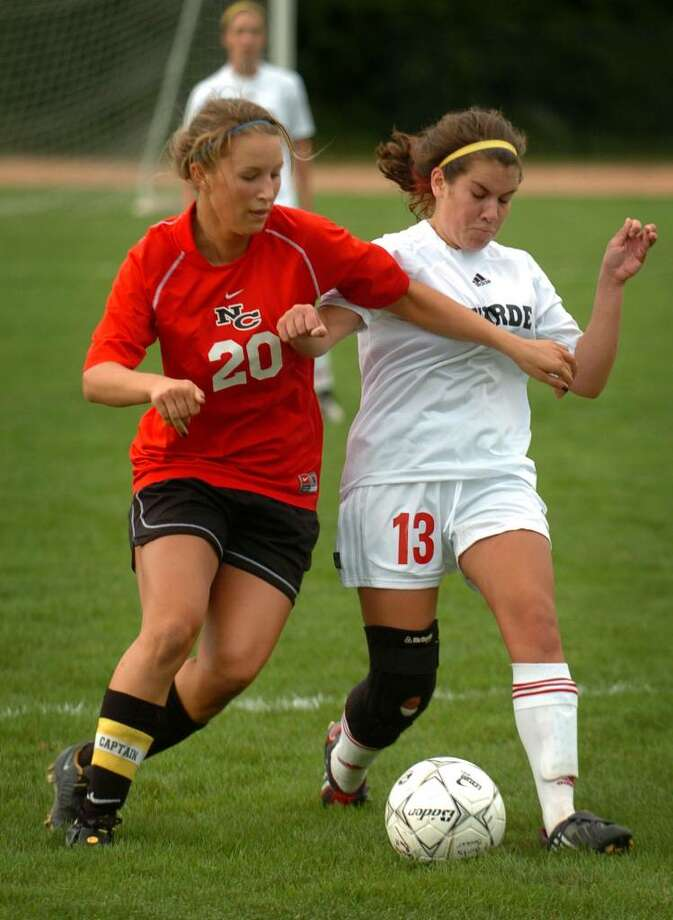 New Canaan's Clare Ashforth, left, battles for the ball with Fairfield Warde's Hannah McGrath during their FCIAC matchup at Warde High School in Fairfield, Conn. on Wednesday, September 30, 2009. Photo: Brian A. Pounds / Connecticut Post