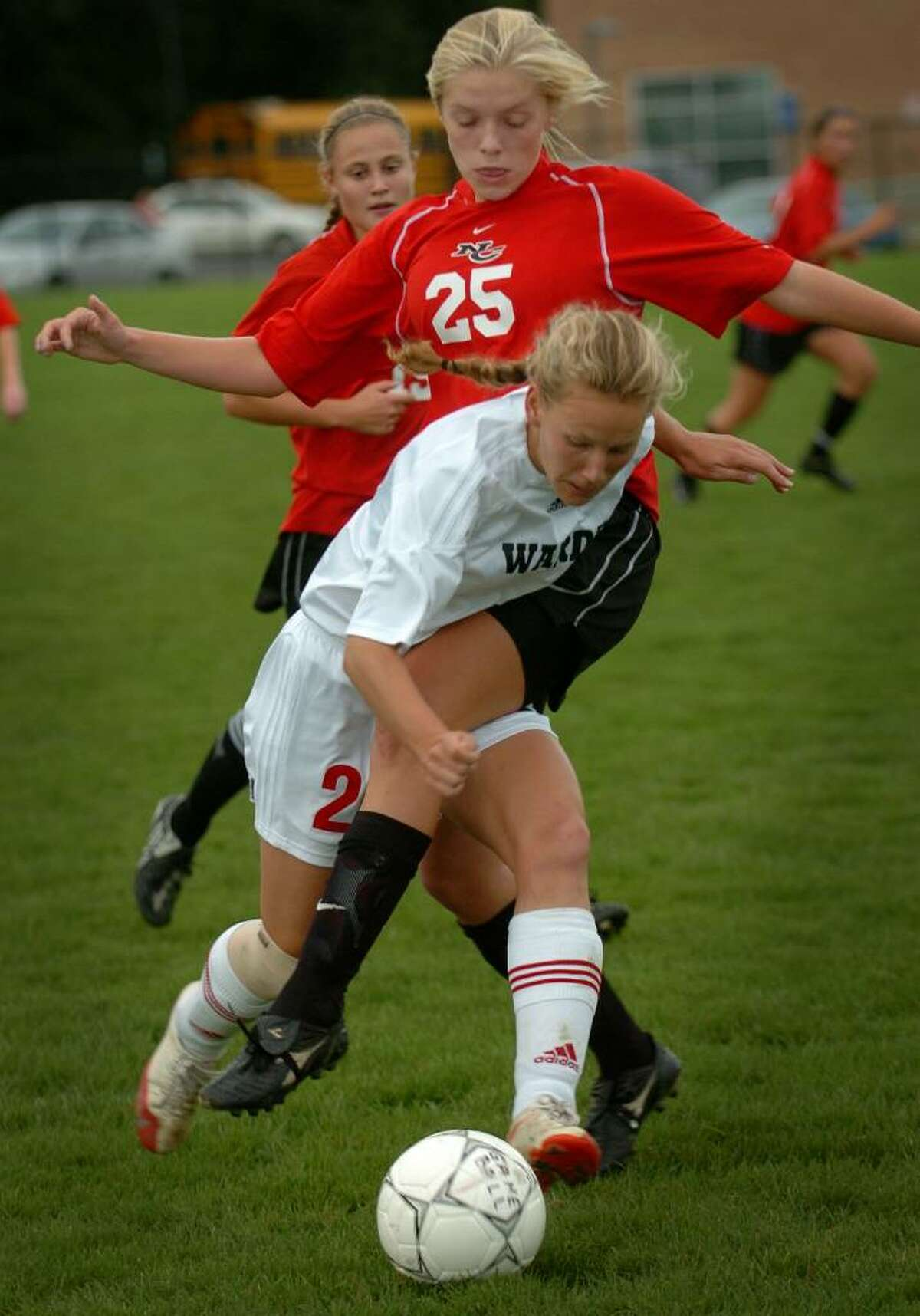 Fairfield Warde's Sarah Duffy locks up with New Canaan defender Kelly Armstrong during their FCIAC matchup at Warde High School in Fairfield, Conn. on Wednesday, September 30, 2009.