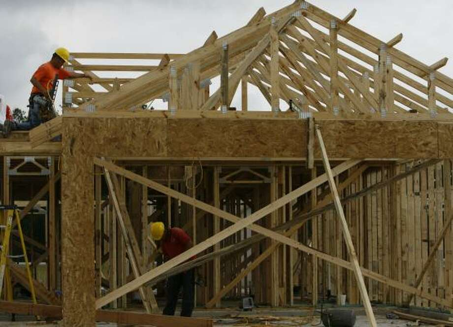 Local home construction may moderate this year, with developers likely building fewer entry-level homes and focusing on the higher-end market. Photo: MELISSA PHILLIP, CHRONICLE