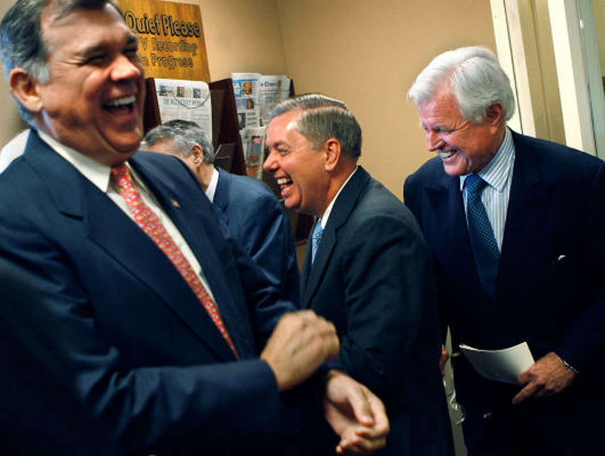 U.S. Sen. Mel Martinez (R-FL), Sen. Lindsey Graham (R-SC) and Sen. Ted Kennedy (D-MA) laugh before a news conference to announce a compromise on immigration legislation between the White House and the Senate at the U.S. Captiol Thursday in Washington, DC. Kennedy was key in negotiating the compromise language in the bill, which U.S. President George W. Bush is expected to sign.