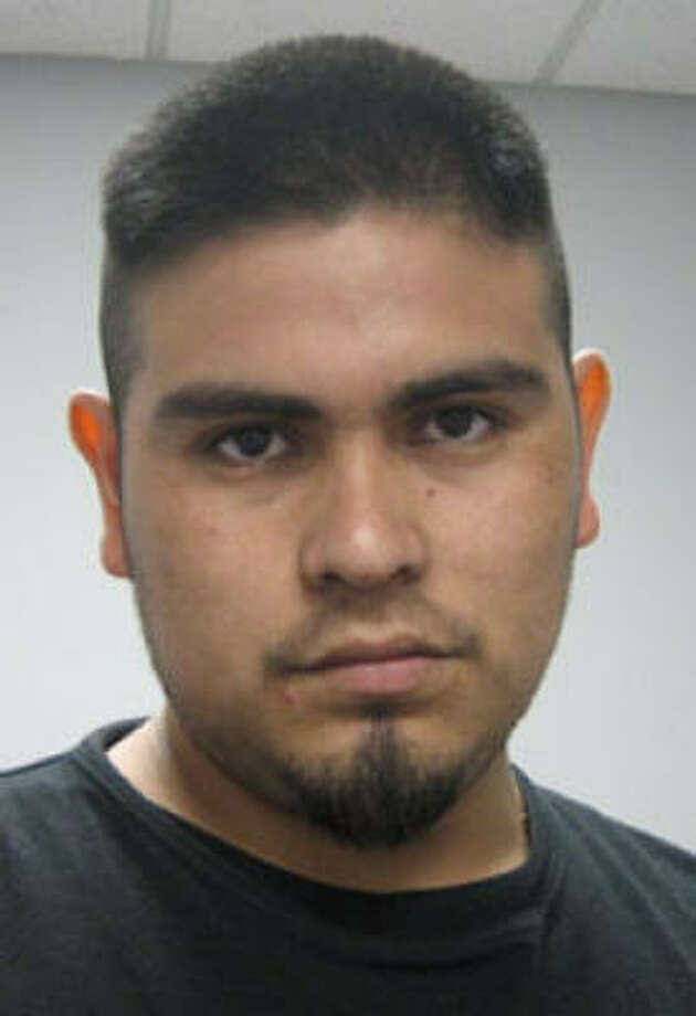 """Pedro Espinoza-Escama, 21, is charged with two counts of compelling prostitution of a minor. He was """"inadvertently"""" released on previous misdemeanor charges Friday. Photo: HPD"""