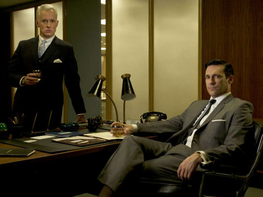 John Slattery, left, and Jon Hamm in the AMC series Mad Men. Photo: AMC