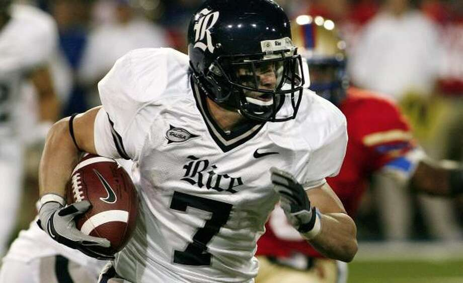 Rice's Tommy Henderson looks for room. Photo: DAVID CRENSHAW, AP