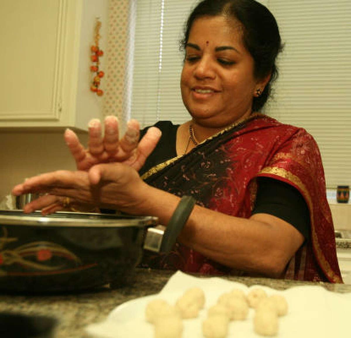 ROLL, DEEP-FRY: When making salt seedai, Latha Ramdas forms a ball of dough, then rolls it into little portions for deep-frying.