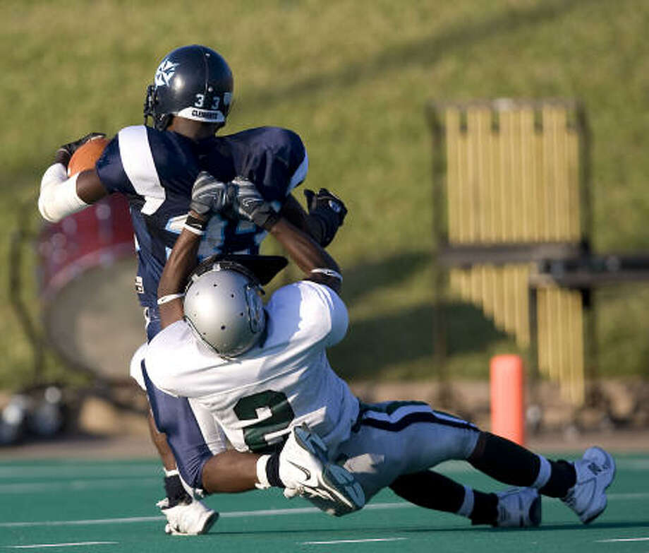 Clements running back Chris Lenoir is dragged down from behind by Hightower's Alex Francis. Photo: Bob Levey, For The Chronicle
