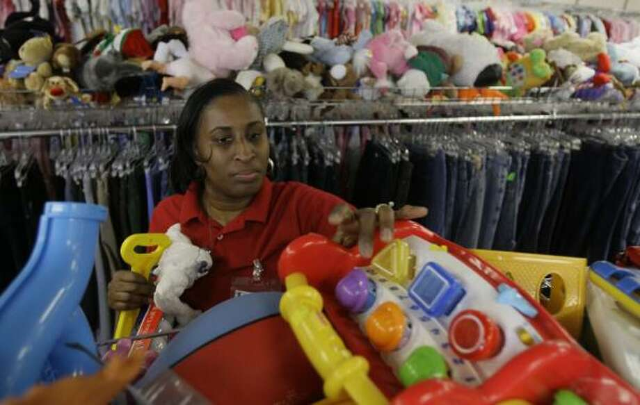 Employee Linda Lewis arranges toys Wednesday at the Goodwill store on the Katy Freeway. A new ruling means thrift stores are not required to have toys tested for lead and chemicals. Photo: MELISSA PHILLIP, CHRONICLE