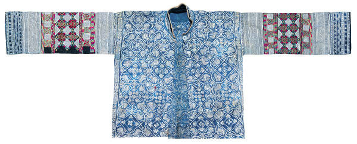 """""""Antique Garment with Bird Patterns"""" from the special exhibit, """"Indigos of China,"""" which features Indigo fabrics, garments and other textile artworks from China."""