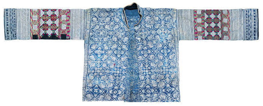 """""""Antique Garment with Bird Patterns"""" from the special exhibit, """"Indigos of China,"""" which features Indigo fabrics, garments and other textile artworks from China. Photo: International Quilt Festival"""