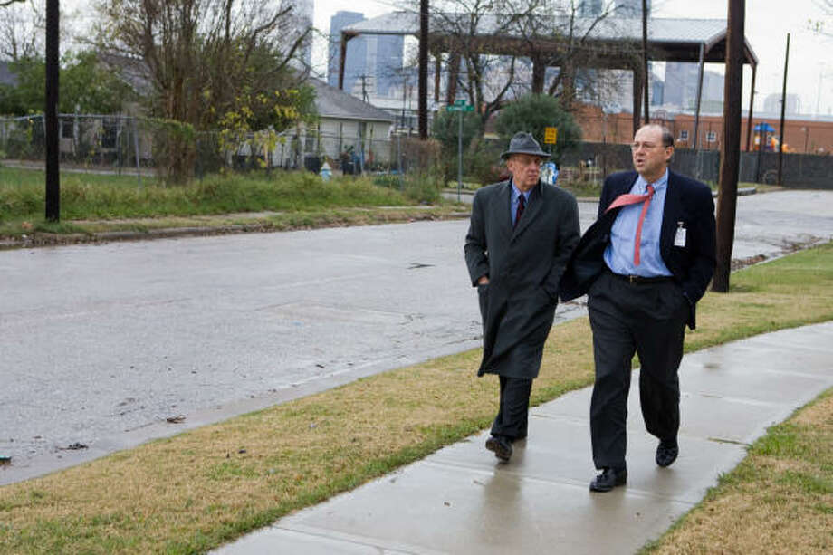 Houston City Councilman Peter Brown, left, talks to Ed Merchant of the Ford Foundation about possible development in the Lower Fifth Ward area. Photo: R. Clayton McKee, For The Chronicle
