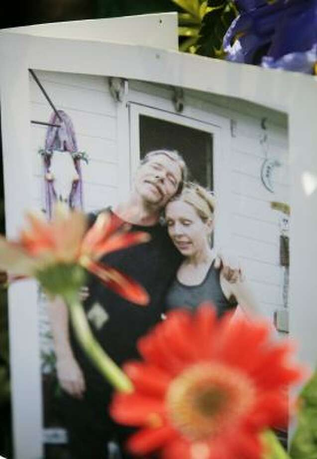 This photo of Tom Jones and his companion, Becky Sargent, was part of an impromptu shrine that has sprung up outside the Art Car Museum in the area where he was fatally struck. Photo: ERIC KAYNE, CHRONICLE