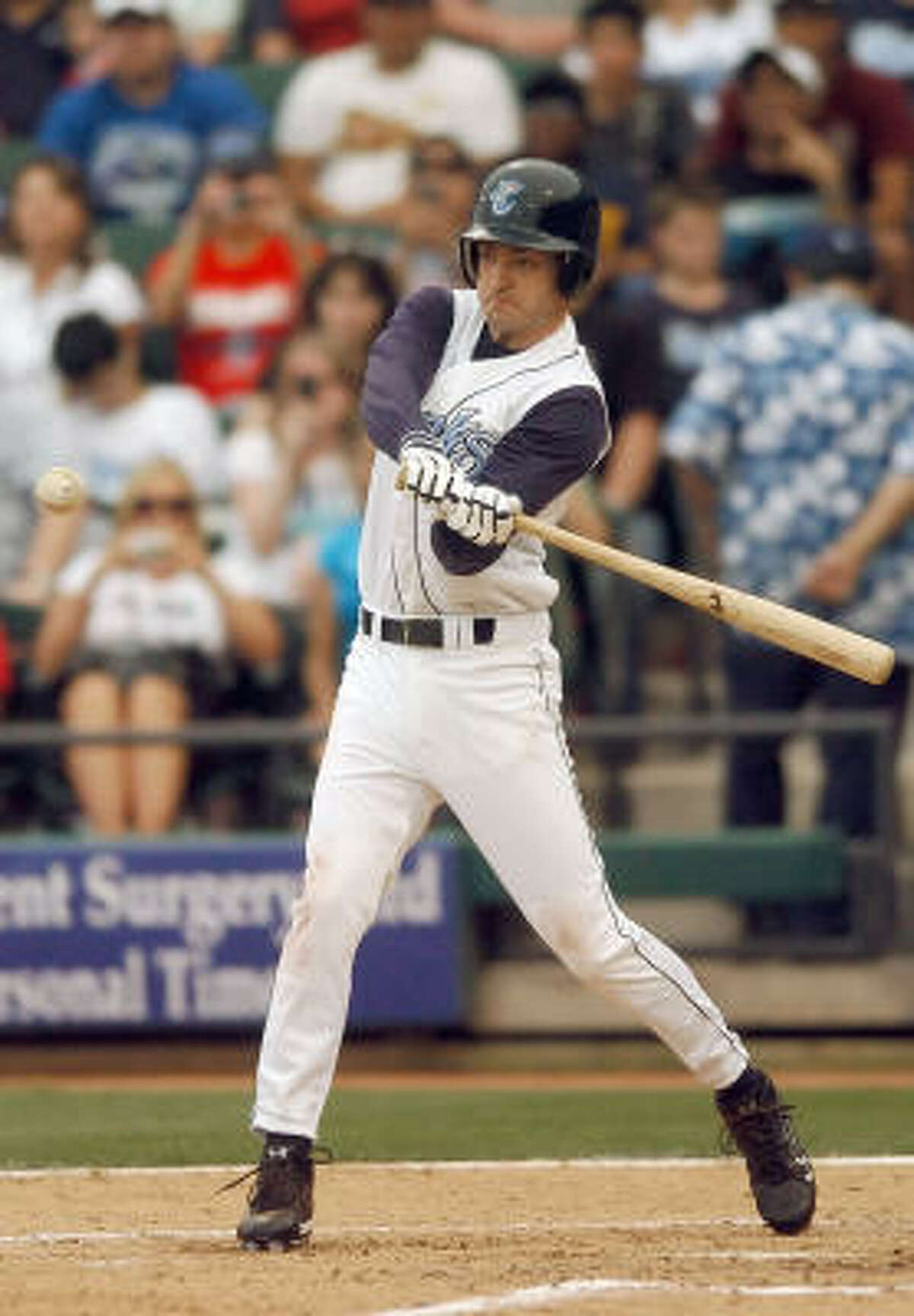 Justin Timberlake, dressed in a Corpus Christi Hooks uniform, takes a swing at a ball during filming of The Open Road, produced by Laurie Foxx.