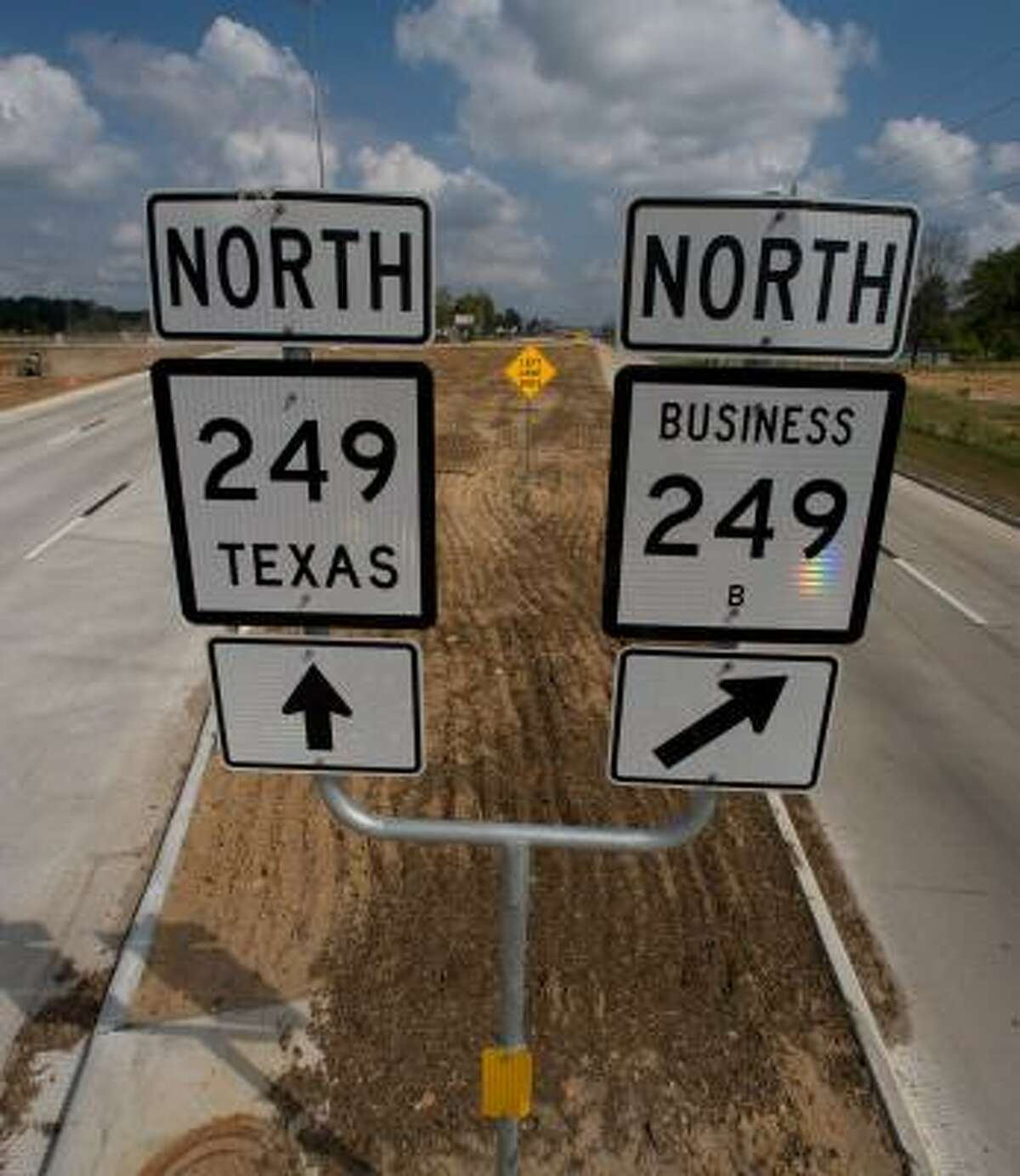 State Highway 249 northbound splits south of Tomball. The right, or business rout goes through town while the left goes to the bypass. Some businesses in Tomball are complaining that their business has declined since TxDot opened a bypass on Texas 249 that allows motorists to avoid the traffic lights in the town's central business district.