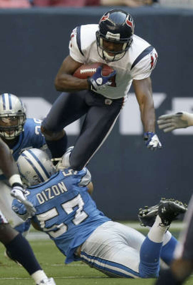 Texans wide receiver Andre' Davis could be out for at least three weeks after undergoing surgery to repair a dislocated ring finger on his left hand. Photo: Brett Coomer, Houston Chronicle