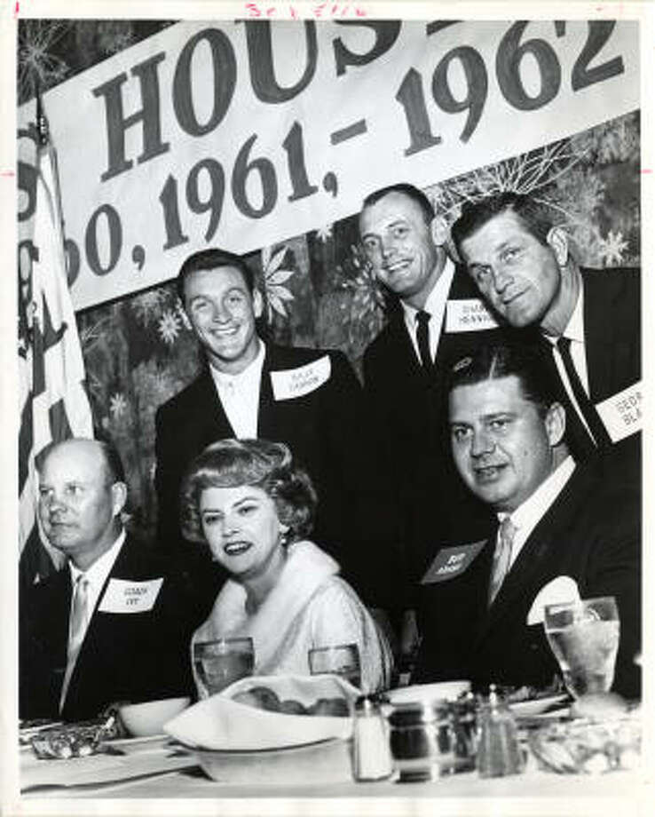 Those attending a dinner honoring the 1960 and 1961 AFL champion Oilers included receiver Charlie Hennigan, top center, quarterback George Blanda, top right, and owner Bud Adams. Photo: Chronicle File Photo