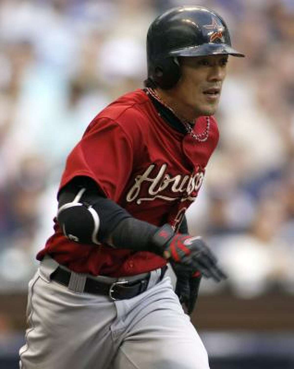 Kaz Matsui runs to first base after connecting on career hit number 2,000 during the third inning Saturday against the Brewers.