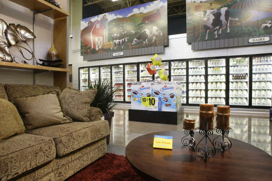 Furniture is displayed near the diary section at the Kroger Marketplace, which opens today in the Richmond area. It's the first of its kind in Texas. Along with groceries, it sells home furnishings and a variety of other products. Photo: MELISSA PHILLIP :, CHRONICLE