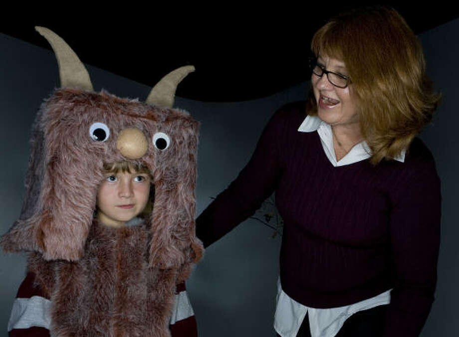 Eight-year-old Lucas Gossett shows off Marshi Young's  Where the Wild Things Are costume. Photo: James Nielsen, Chronicle