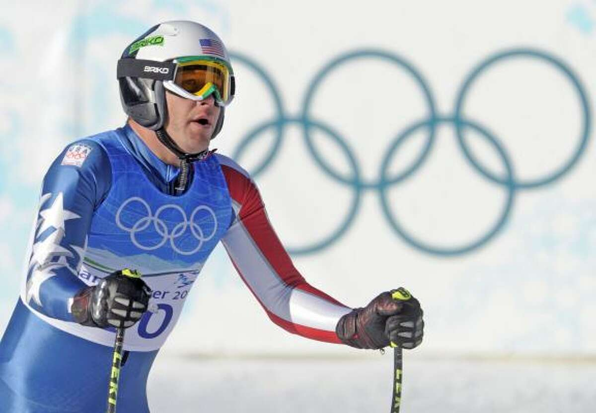 Bode Miller of the United States relaxes after completing the downhill portion of the two-part event.