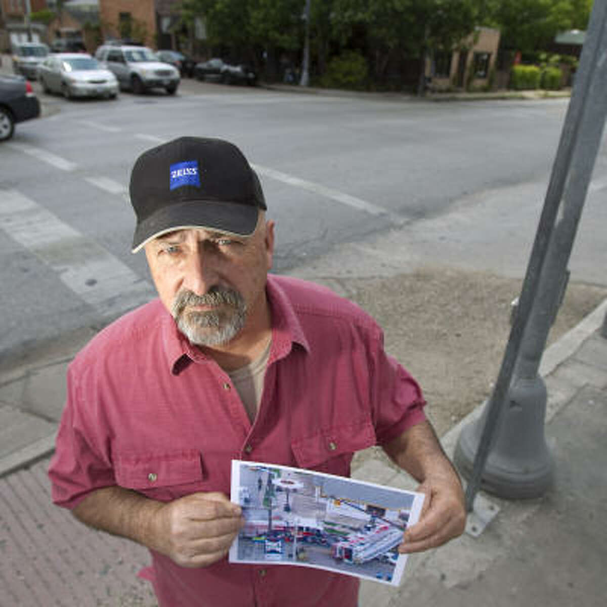 Warren Ducote, who was at the wheel of the Houston Fire Department ladder truck, revisits the scene of the accident at Westheimer and Dunlavy with a photo of the wreckage.