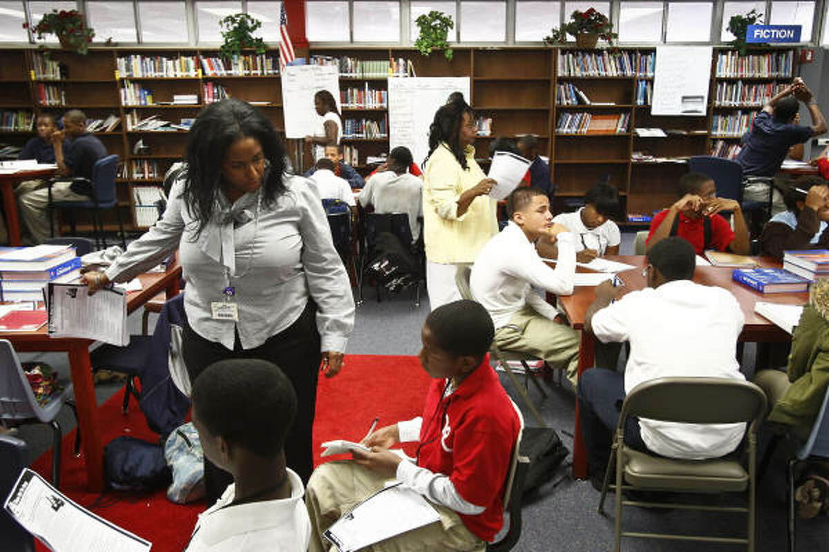 The strategy at Thomas Middle School has multiple teachers instructing large groups of students. Teachers Verlia Reed-Byrd, standing left, Tuesday Neal, standing in background, and Sherian Scott lead an English class of 85 on Tuesday.