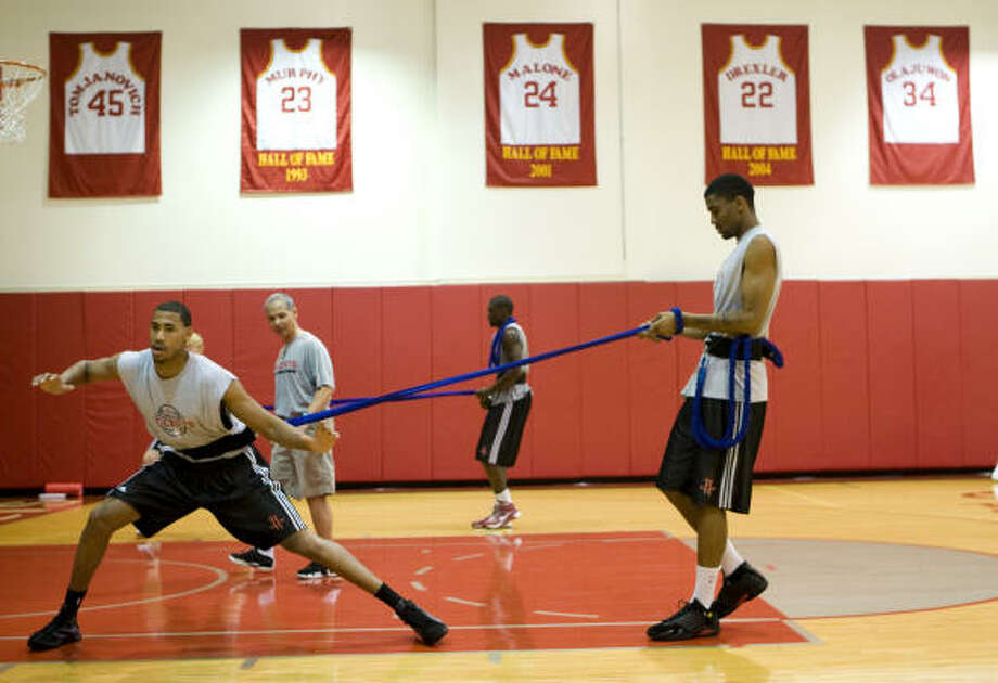 Garrett Temple, left, and James White work out at Toyota Center on Thursday. Photo: Brett Coomer, Chronicle