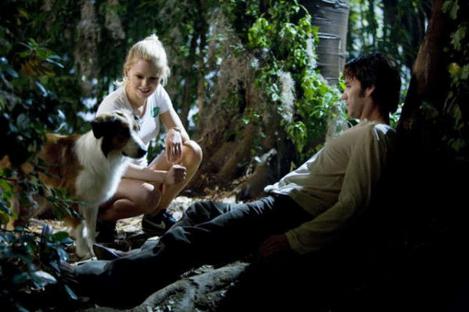 Sookie Stackhouse, played by Anna Paquin, Bill Compton, played by Stephen Moyer, and Dean the dog star in True Blood, based on Charlaine Harris' Southern Vampire series. Photo: HBO