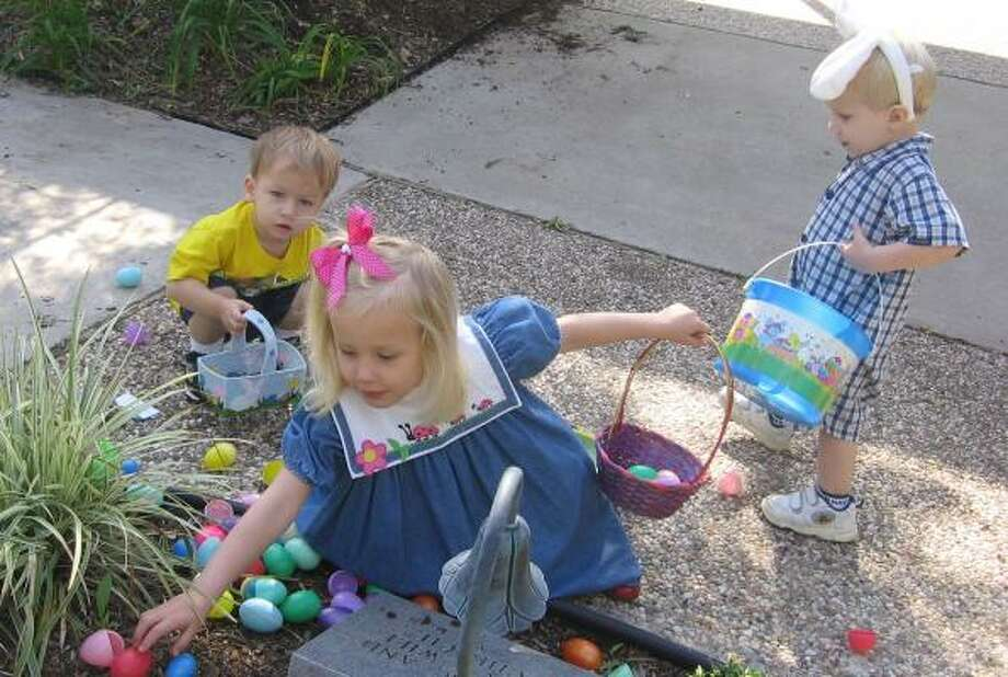 Children put their egg-hunting skills to work. A survey's findings indicate fewer Americans today associate Easter with the resurrection of Jesus Christ. Photo: COURTESY PHOTO