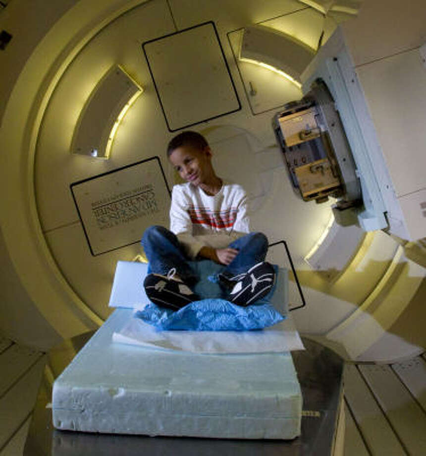 Karim Apollon, 8, has his final radiation treatment in Houston today at M.D. Anderson's Proton Therapy Center. Photo: Johnny Hanson, Chronicle