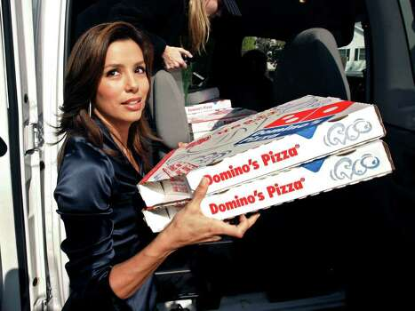 "Actress Eva Longoria, star of ABC's  ""Desperate Housewives, distributes pizzas to film and TV writers who converged on a house  near Warner Bros. studio, serving as a location shoot for ""Desperate Housewives"" Tuesday, Nov. 6, 2007, in the Toluca Lake section of Los Angeles. Photo: Ric Francis, AP / AP"