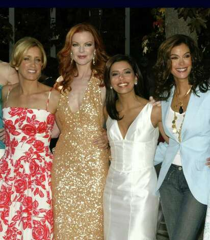 "The cast of ""Desperate Housewives"" poses for photographers after arriving for an ABC  event May 17, 2005, in New York. From left are, Felicity Huffman, Marcia Cross, Eva Longoria, and Teri Hatcher.   Huffman received two Golden Globe nominations Tuesday, Dec. 13, 2005, for best dramatic actress in a film for her role as a man preparing for sex-change surgery in ""Transamerica"" and best actress in a TV musical or comedy for ""Desperate Housewives."" Her three co-stars were also nominated for best actress in a TV musical or comedy. The series was also nomination for a Golden Globe. Photo: KATHY WILLENS, AP / AP"