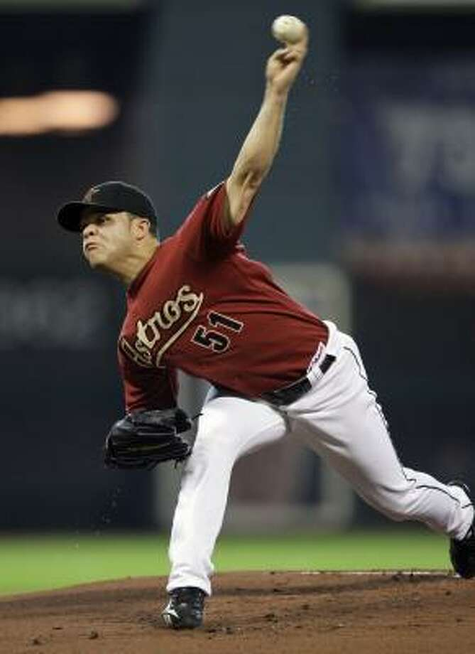 Astros pitcher Wandy Rodriguez delivers a pitch against the St. Louis Cardinals during the first inning of Sunday's 5-4 loss. Photo: David J. Phillip, AP