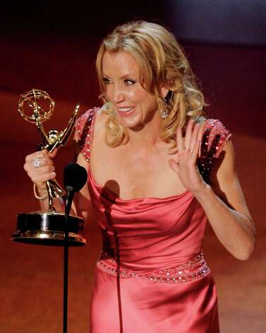 "Felicity Huffman accepts the award for outstanding lead actress in a comedy series for her work on ""Desperate Housewives"" at the 57th Annual Primetime Emmy Awards Sunday, Sept. 18, 2005, in Los Angeles. Photo: MARK J. TERRILL, AP / AP"