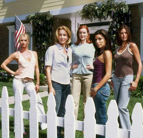 "**FILE**The stars of the hit primetime series, ""Desperate Housewives,"" pose on the show's set in this 2004 publicity photo. From left, are Nicollette Sheridan, Felicity Huffman, Marcia Cross, Eva Longoria and Teri Hatcher. the show was among top nominees announced Thursday, July 14, 2005, for the 57th Annual Primetime Emmy Awards. Photo: MOSHE BRAKHA, AP / ABC, INC."