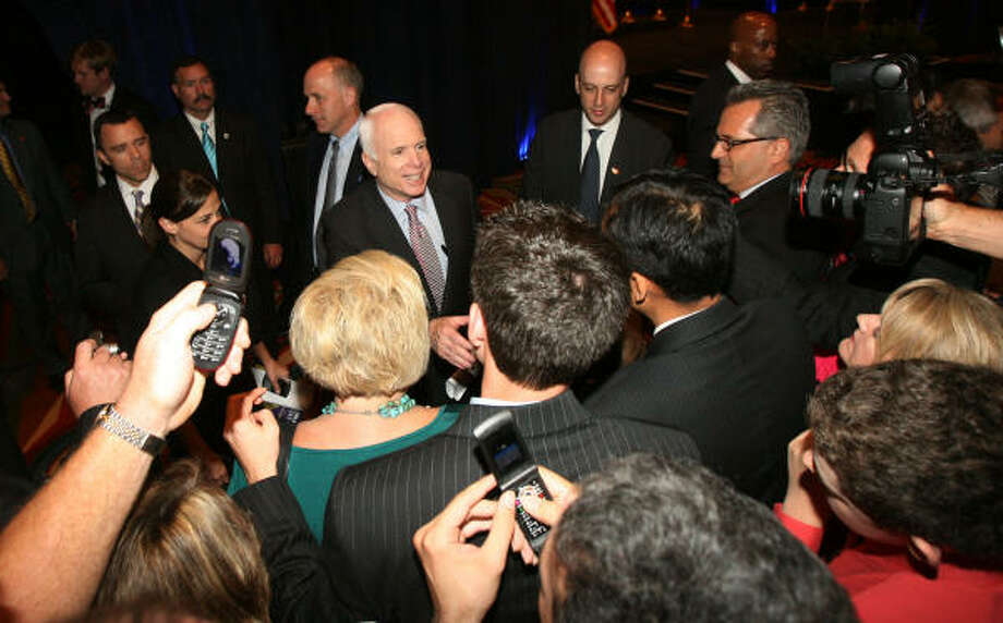 A crowd swarms Republican presidential candidate John McCain at the Hilton in downtown Houston on Tuesday. Photo: Billy Smith II, Chronicle