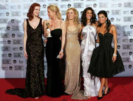 "The cast of ""Desperate Housewives,"" from left to right, Marcia Cross, Nicolette Sheridan, Felicity Huffman, Teri Hatcher, and Eva Longoria pose backstage after accepting the award for best television series musical or comedy at the 62nd Annual Golden Globe Awards on Sunday, Jan. 16, 2005, in Beverly Hills, Calif. Photo: REED SAXON, AP / AP"