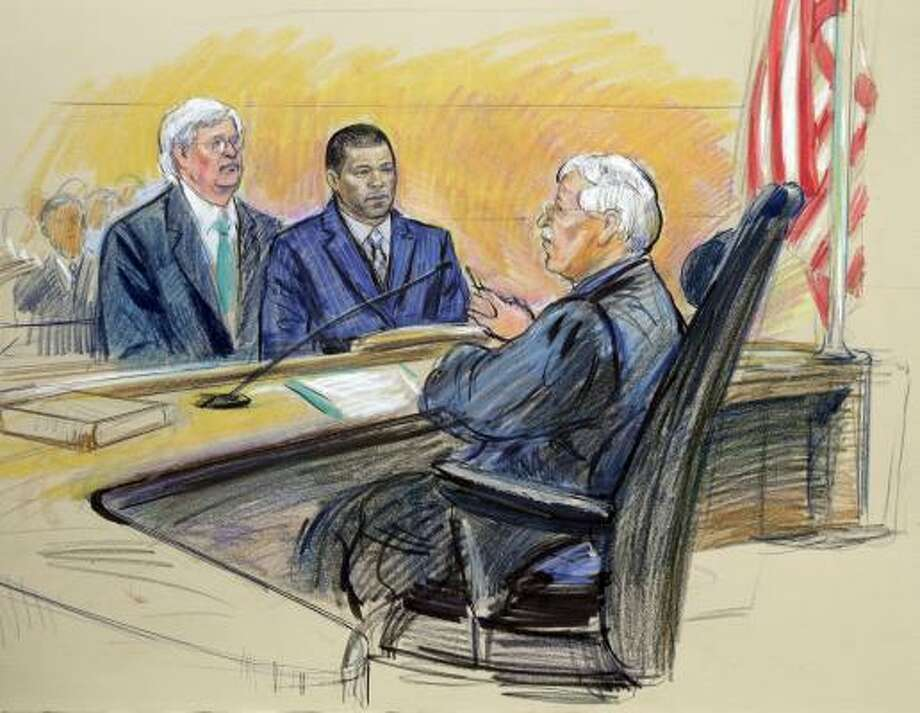 In this artist rendering, Miguel Tejada, center, is accompanied by his attorney Mark Tuohey, left, before U.S. Federal District Court Judge Alan Kay. Photo: Alex Brandon, AP
