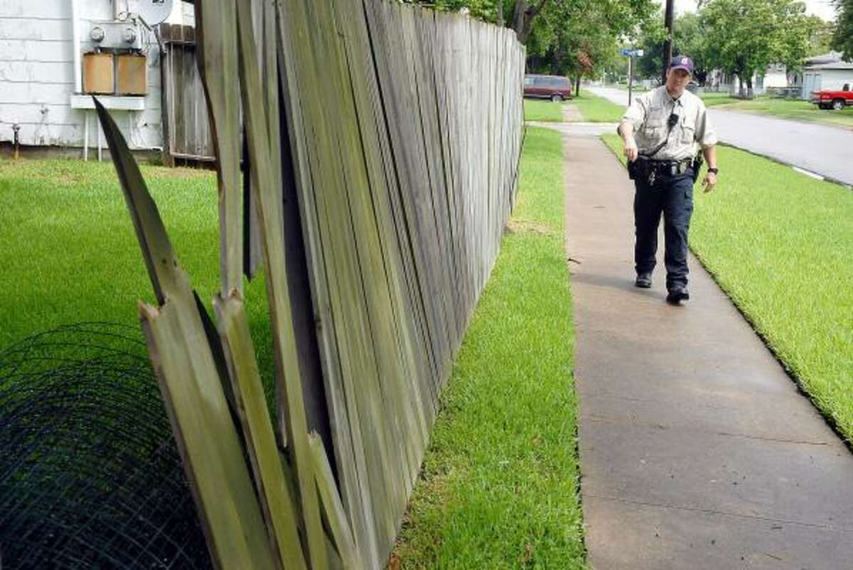 Grandstaff looks for city code violations like this fence. Texas City has targeted the Chelsea subdivision for an experiment in enforcing property codes.