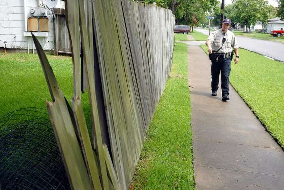 Grandstaff looks for city code violations like this fence. Texas City has targeted the Chelsea subdivision for an experiment in enforcing property codes. Photo: DAVE ROSSMAN, FOR THE CHRONICLE