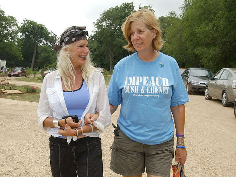Bree Walker, left, walks with Cindy Sheehan, right, at Camp Casey, Friday in Crawford. Walker purchased the land from Cindy after she put it up for sale. Photo: Jerry Larson, For The Chronicle