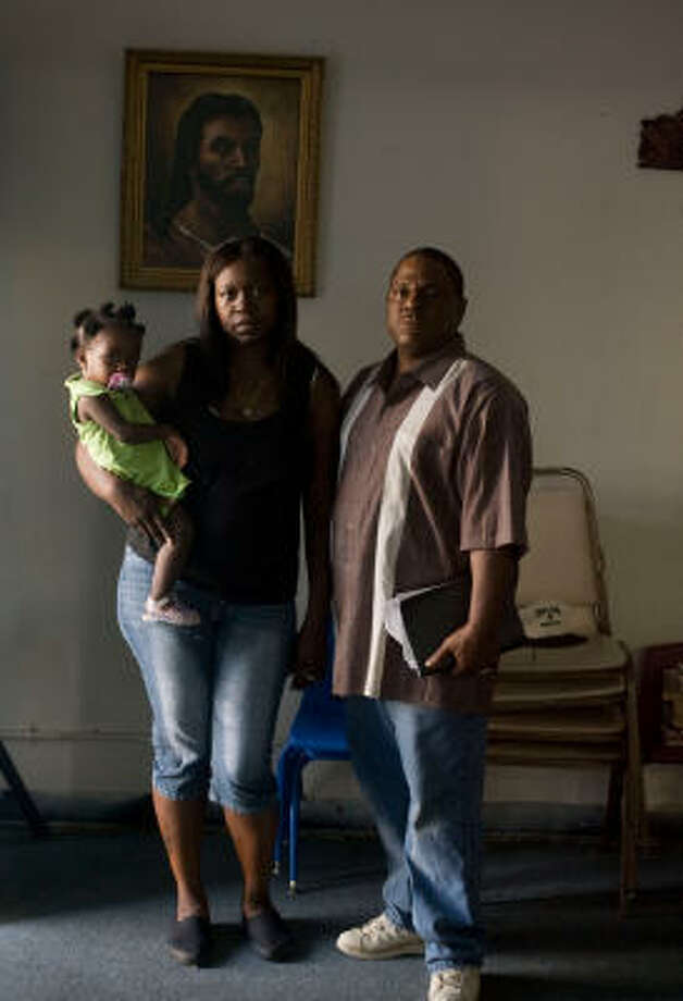 Lillie Martinez (with granddaughter Miesha Batiz and her pastor, Bishop Samuel Daniels) is the mother of Robert Brown, 15, who was certified as an adult and sent to prison. Photo: Billy Smith II, ALL