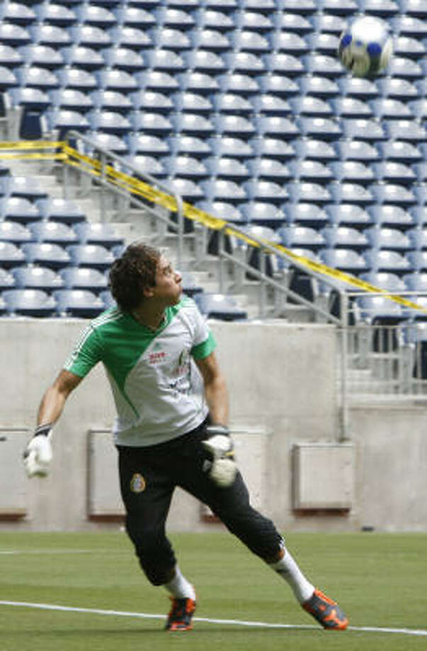 As the last line of defense, goalkeeper Francisco Guillermo Ochoa is one of the players under the most pressure for the highly scrutinized Mexican team. Photo: Julio Cortez, Chronicle