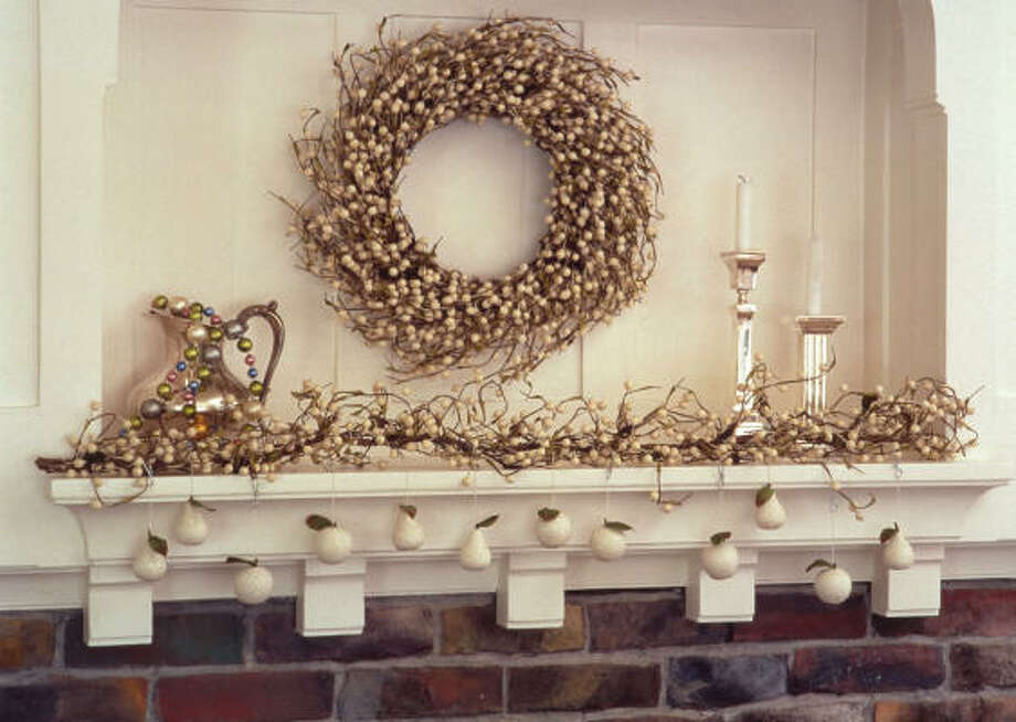 White faux tallow berries turned into a wreath and mantel decorations. Photo: Smith & Hawken