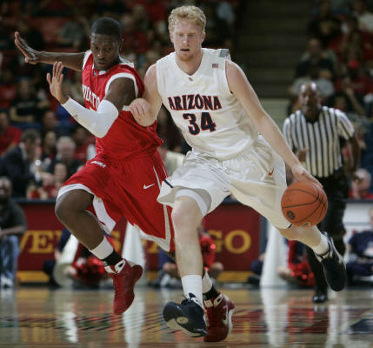 Houston's Aubrey Coleman was called for a flagarant foul on Arizona's Chase Budinger.