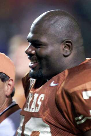 FILE--Texas' All-American offensive tackle Leonard Davis stands on the sideline in Austin, Texas, during a game on Nov. 24, 2000. Davis, 6-foot-6, 365 pounds, is a big reason why the 12th-ranked Longhorns will play Friday in the Holiday Bowl against No. 8 Oregon. Photo: HARRY CABLUCK, AP / AP