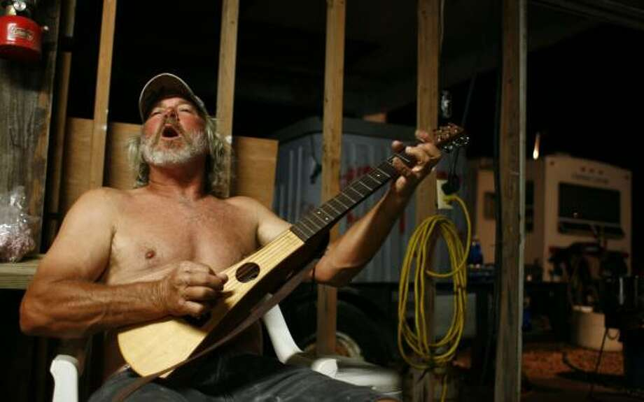 Cornell Strimple lifts his voice in song, competing with the noise of generators that provide power for a makeshift community center at a dock near the Intracoastal Waterway in Port Bolivar. Photo: SHARÓN STEINMANN PHOTOS, CHRONICLE
